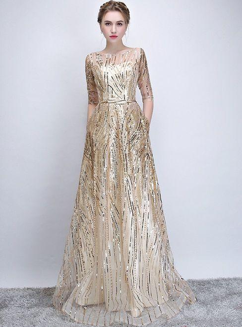 abito da sposa avorio e oro