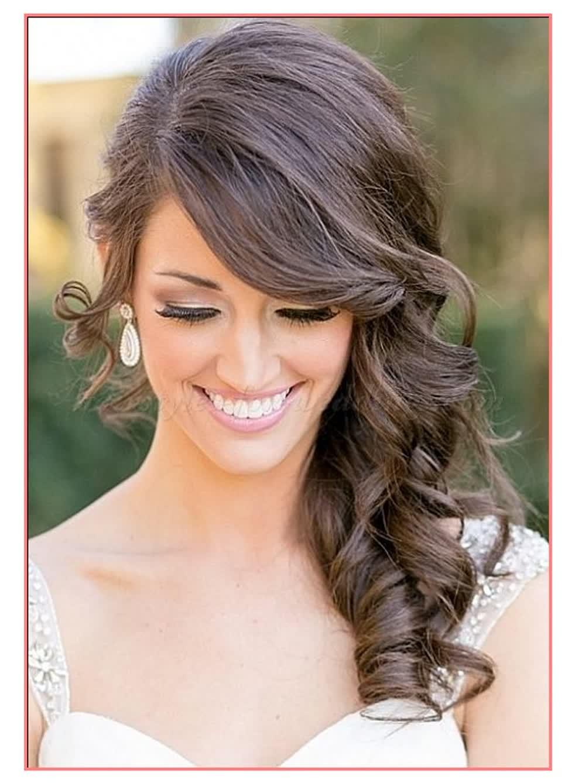 Acconciature capelli lunghi ricci raccolti di lato ...