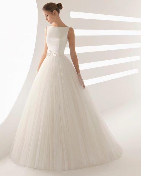 abito da sposa minimal con gonna ampia in tulle