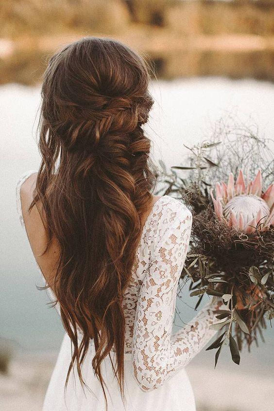 acconciatura da sposa semiraccolta con trecce