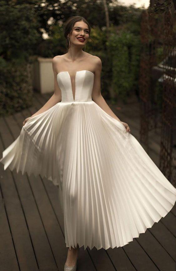 abito da sposa longuette con gonna plissè
